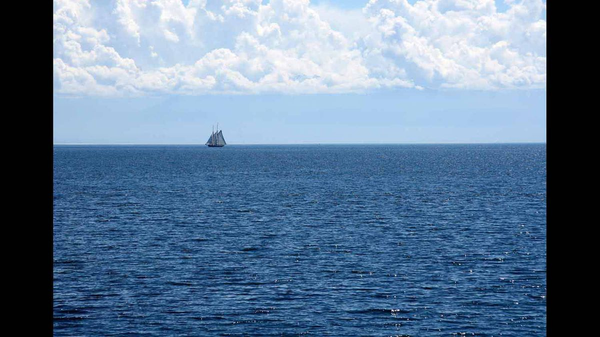A boat sails off the coast of Victoria BC. 2010.