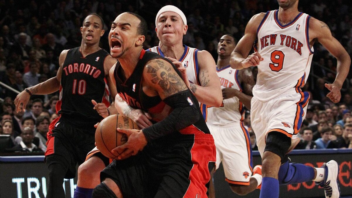 The Toronto Raptors' Jerryd Bayless, left, is fouled by the New York Knicks' Mike Bibby.