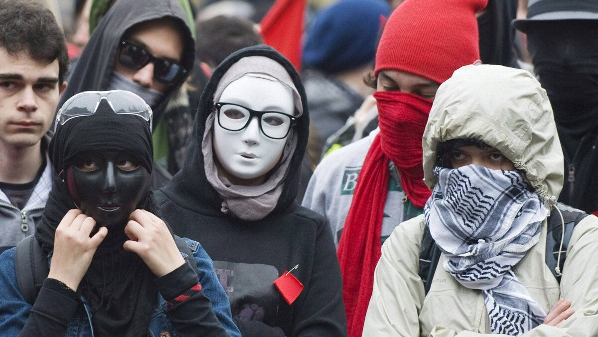 Masked protesters take part in an anti-capitalist demonstration in Montreal, Tuesday, May 1, 2012.
