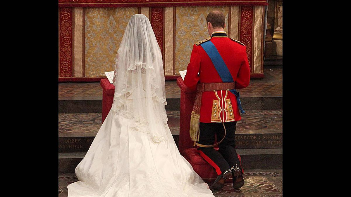 Britain's Prince William and Kate Middleton kneel at the altar of Westminster Abbey in London during their Royal Wedding ceremony on April 29, 2011.