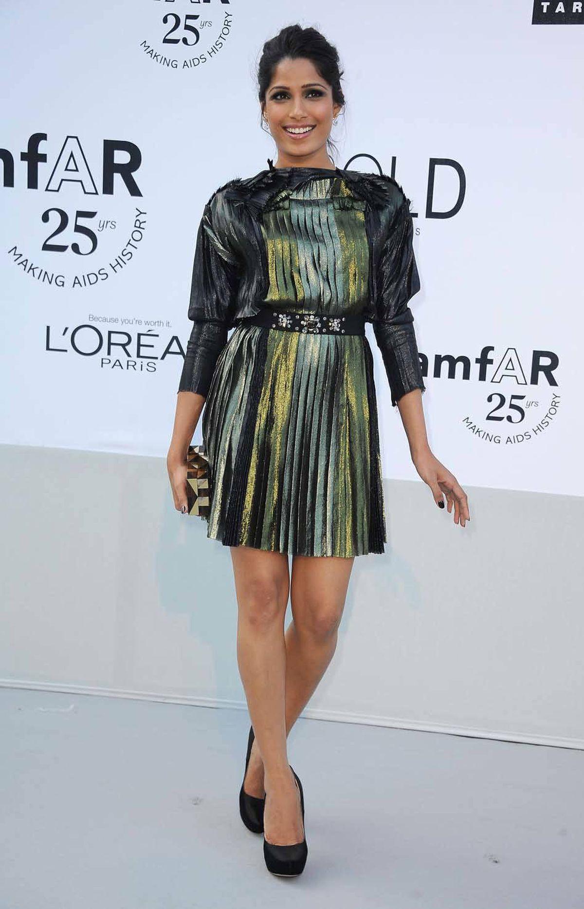 Freida Pinto attends amfAR's Cinema Against AIDS Gala at the Cannes Film Festival on Thursday.