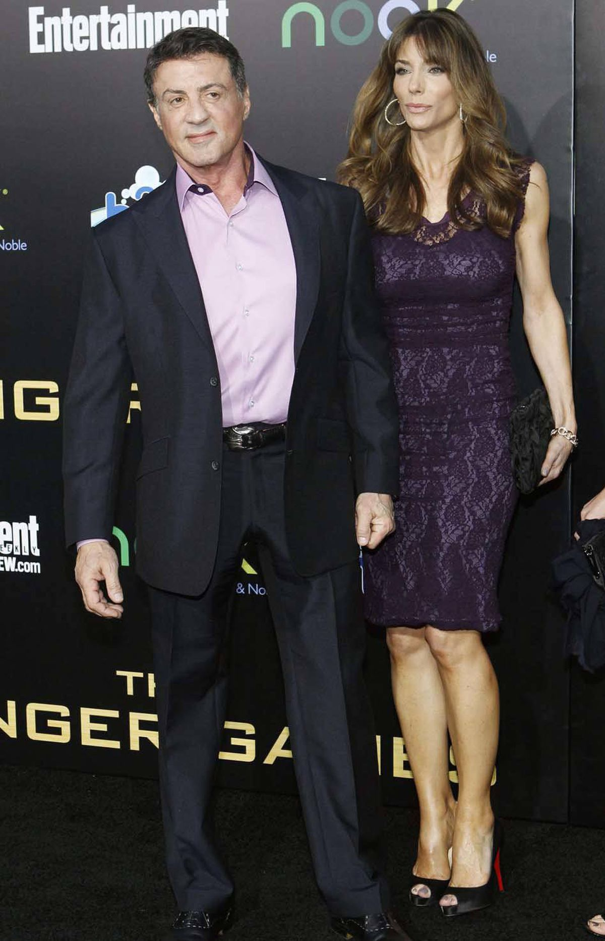 """Did someone say 'Rambo'?"" Sylvester Stallone, with his wife Jennifer Flavin, asks at the premiere of ""The Hunger Games"" in Los Angeles last week."