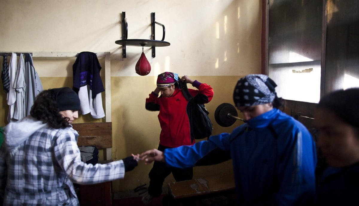 Afghan women prepare to leave after a practice session inside a boxing club in Kabul December 26, 2011.