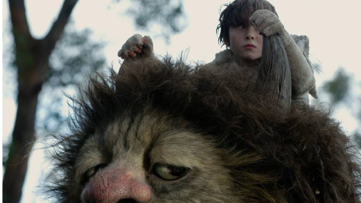 In this film publicity image released by Warner Bros. Pictures, Max Records, portraying Max, is shown with the character Carol, voiced by James Gandolfini in 'Where the Wild Things Are.'