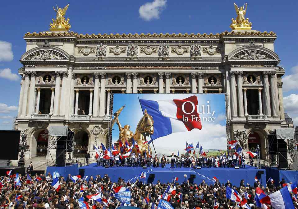 France's far-right National Front candidate for the presidential election Marine Le Pen, center, delivers her speech at Opera during the traditional May Day march in Paris. After Socialist party candidate Francois Hollande won a slim upper hand in the first round of voting, President and conservative candidate Nicolas Sarkozy candidly ogled voters of the far-right National Front whose candidate, Marine Le Pen, placed a solid third.