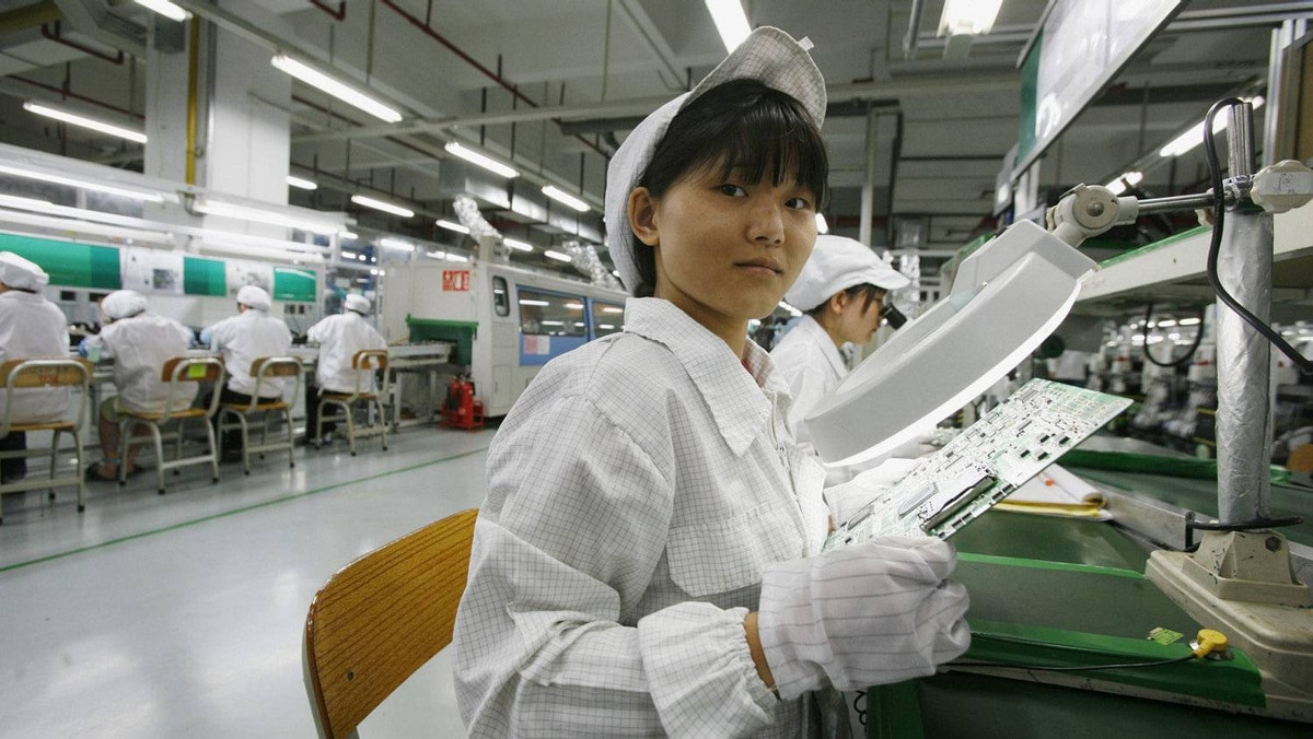 Huang Xuehua, 24, from Guangdong province works inside a Foxconn factory in the township of Longhua in the southern Guangdong province May 26, 2010.
