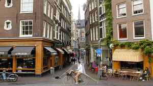 A street scene in Amsterdam, Sept. 11, 2011. Belying their frugal national stereotype, the Dutch are actually the euro-zone champs when it comes to personal – as opposed to government – loans, and the Irish are just a step behind, according to a report by Martin Schwerdtfeger, senior economist at TD Economics.