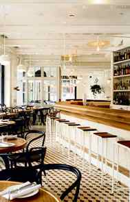 MIX IT UP n the bright and airy brasserie-inspired bar, yellow, charcoal and cream Escher-patterned tiles cover the floor, bead-board panelling lines the walls and every surface gleams with ivory paint. Throw in industrial lighting fixtures and sculptural black bentwood chairs and there's the inspiration for your next kitchen reno.