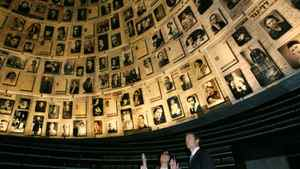 Canadian Foreign Minister Peter MacKay (R) looks at pictures of Jews killed during the Holocaust, during a visit to the Hall of Names at the Yad Vashem Holocaust Memorial in Jerusalem January 21, 2007.