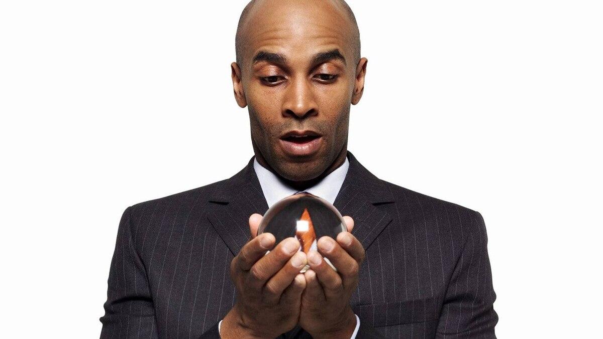 Businessman holding a crystal ball.