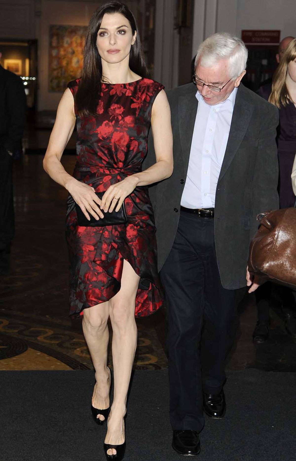 "Back on the red carpet, director Terence Davies is the quintessence of subtlety as he escorts Rachel Weisz into the premiere of ""The Deep Blue Sea"" in New York City last week."