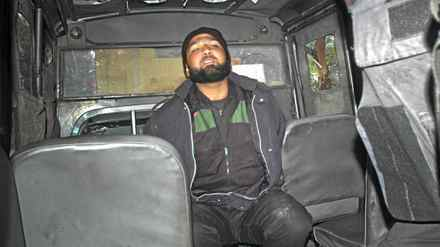 Malik Mumtaz Hussain Qadri, a man identified as a guard of the governor of Punjab province Salman Taseer, is detained at the site of Taseer's shooting in Islamabad January 4, 2011. A gunman assassinated the governor of Pakistan's Punjab province, a senior member of the ruling party, in Islamabad on Tuesday, an aide said, as a new political crisis gripped the strategic U.S. ally. Salman Taseer was killed by one of his guards because of his opposition to Pakistan's controversial blasphemy law, Interior Minister Rehman Malik said.