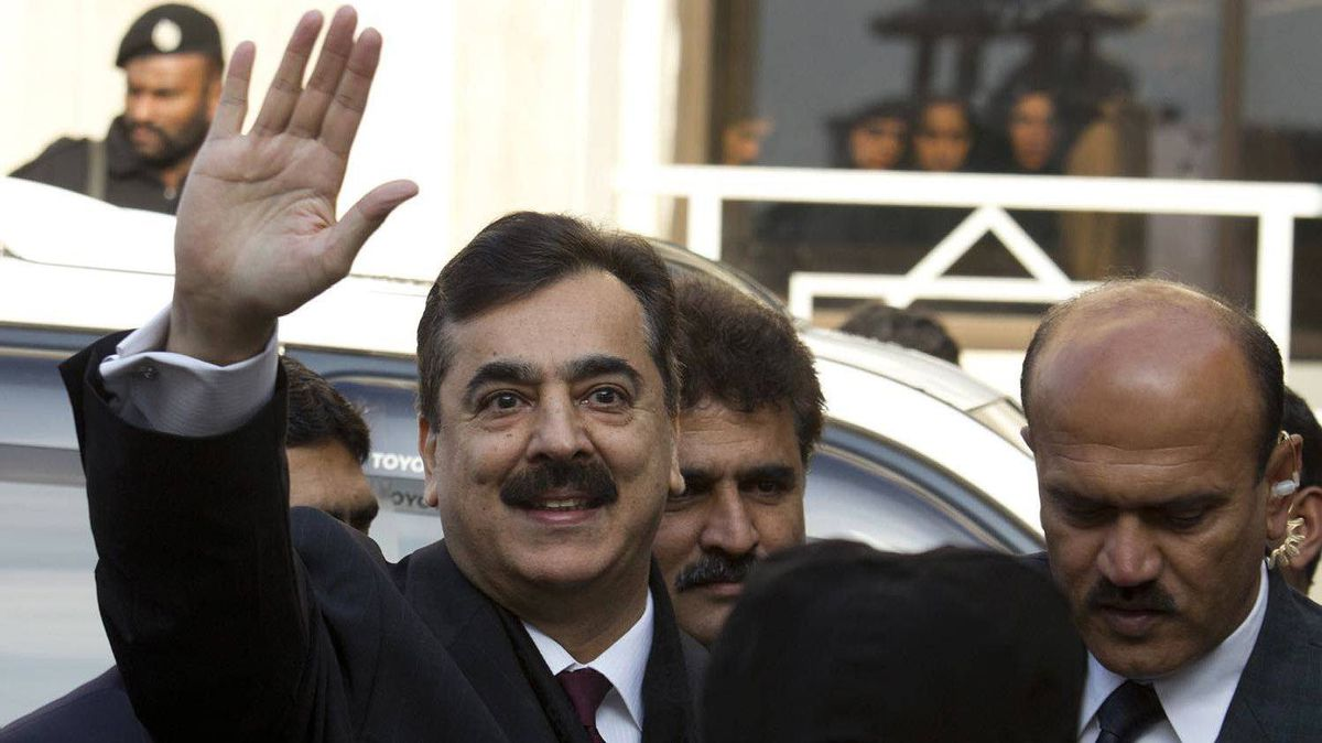 Pakistani Prime Minister Yousuf Raza Gilani waves upon his arrival at the Supreme Court in Islamabad on Jan. 19, 2012.