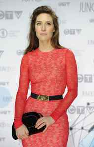 Feist poses for photographers as she arrives on the red carpet at the Juno Awards in Ottawa, Sunday April 1, 2012.