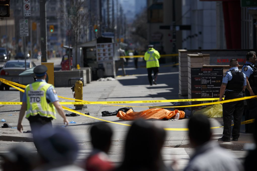 6617641efb9202 A tarp lays on top of a body on Yonge St. at Finch Ave. after a van runs  into pedestrians on April 23