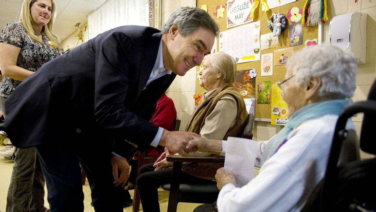 Liberal Leader Michael Ignatieff greets residents at an old age home on election day, Monday, May 2, 2011 in Toronto.