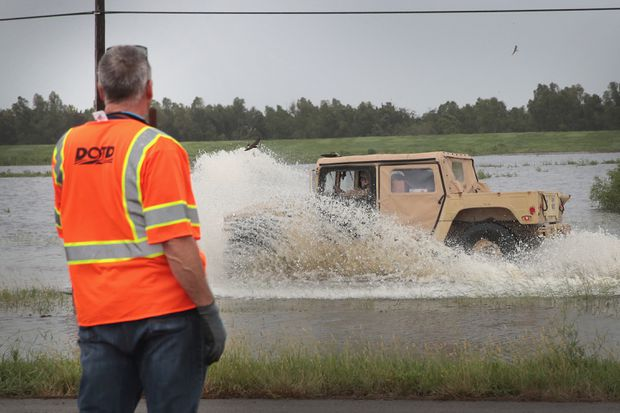 Weakened storm Barry unleashes blast of torrential rains on parts of southern U.S.