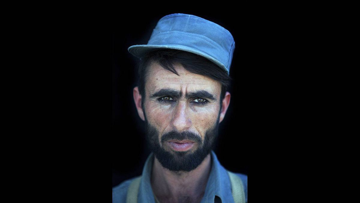 """Ton Koene of the Netherlands has won the second prize Portraits Stories with the series """"Recruits at police training center"""". New Afghan police recruits at the German police training centre in Kunduz, Afghanistan. All are illiterate; they are farmer sons from rural areas who never had any education and are joining the police for economic reasons. Their loyalty to the government is thin. A police officer earns around $170 per month, and due to harsh living and working conditions and as well the high risk for being killed by the Taliban, many decide to leave the police force before their contract ends."""