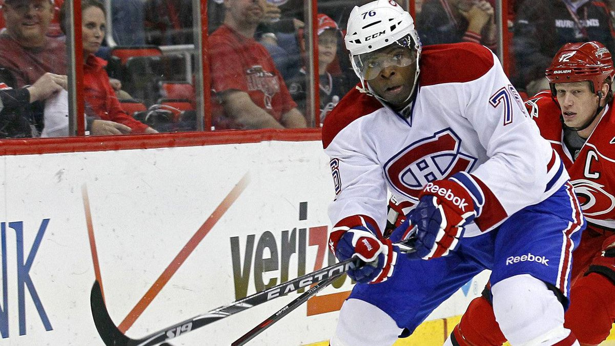 Montreal Canadiens' P.K. Subban controls the puck as Carolina Hurricanes' Eric Staal chases during the first period of an NHL hockey game in Raleigh, N.C., Thursday, April 5, 2012.