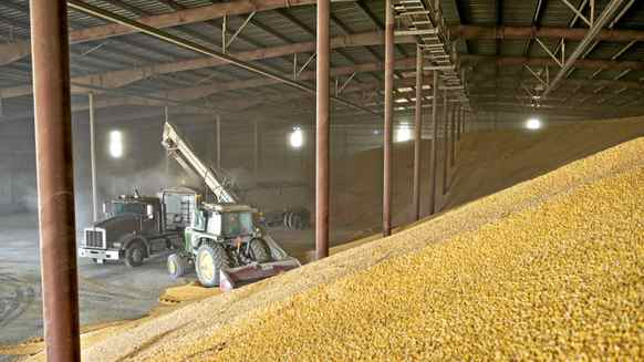 Corn sits in a Michlig AgriCenter Inc. storage facility in Sheffield, Ill. The smallest corn inventories in 37 years are a sign farmers around the globe are failing to produce enough grain to meet rising consumption, even as planting expands and food prices surge.