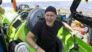 James Cameron emerges from the Deepsea Challenger submersible after his successful solo dive to the Mariana Trench, the deepest part of the ocean, March 26, 2011.