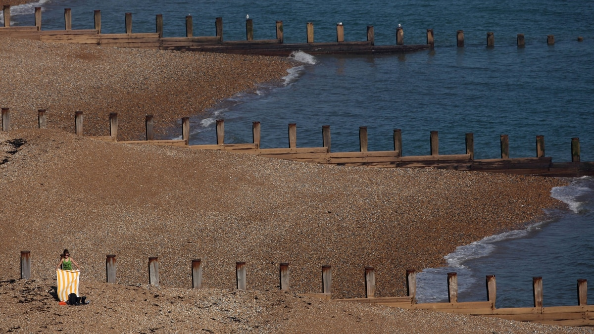 A girl lays her towel out on Eastbourne beach on September 28, 2011 in Eastbourne, England. Much of the UK is enjoying a spell of unseasonably hot weather which is expected to last into next week.