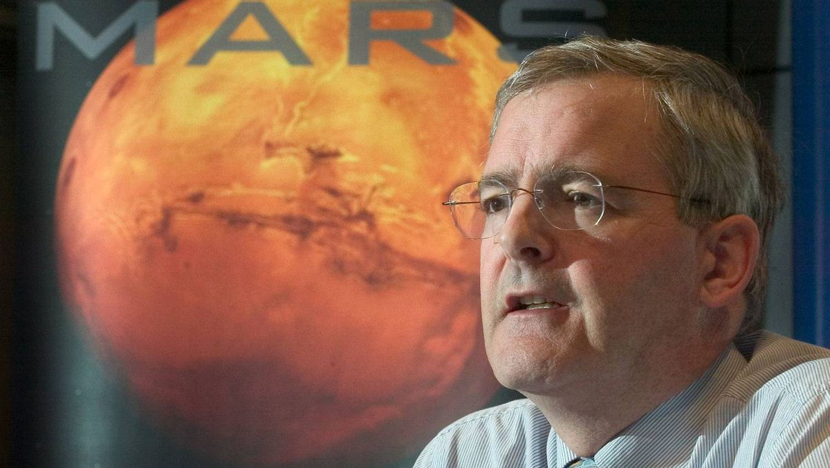 Marc Garneau, head of the Canadian Space Agency, reviews the agency's accomplishments and activities planned for 2004 during a news conference Tuesday, Jan. 14, 2004 in Longueuil, Que. Garneau said he hoped to have a Canadian exploration mission on Mars.