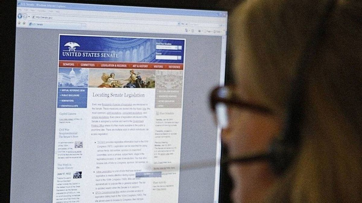 A journalist checks the U.S. Senate's website after it was attacked by internet hackers in Washington June 13, 2011.