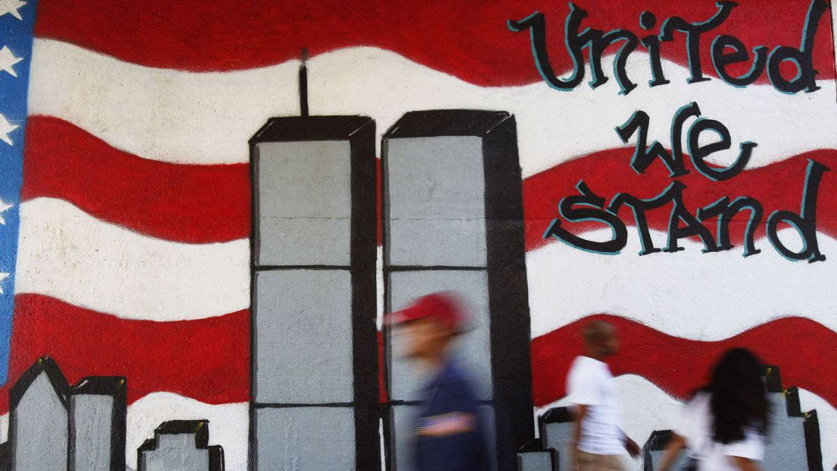 People walk past a mural in the Queens borough of New York honouring victims of the Sept.11, 2001, attacks on the World Trade Center.