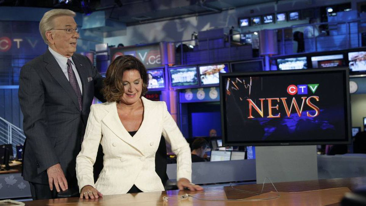 Lloyd Robertson, the chief anchor of CTV News who is retiring next year, welcomes his successor Lisa LaFlamme, at the network's studios in Toronto.