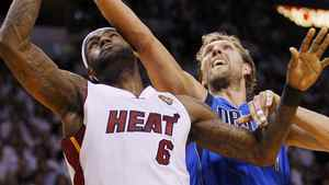 Dallas Mavericks' Dirk Nowitzki (R) and Miami Heat's LeBron James battle for position during Game 6 of the NBA Finals basketball series in Miami, June 12, 2011. REUTERS/Mike Segar