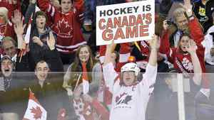 Canada fans cheer as Team Canada takes on Team Finland during second period IIHF World Junior Championships hockey action in Edmonton, on Monday, Dec. 26, 2011. THE CANADIAN PRESS/Nathan Denette