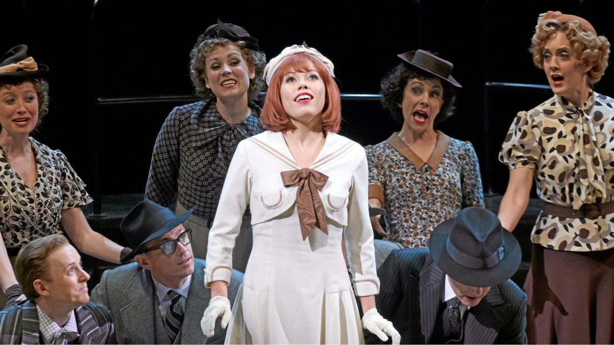 Jennifer Rider-Shaw as Peggy Sawyer with members of the company in 42nd Street.