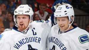 Alexander Edler #23 of the Vancouver Canucks celebrates his first period goal against the Ottawa Senators with teammate Henrik Sedin #33 during an NHL game at Scotiabank Place on December 10, 2011 in Ottawa, Ontario, Canada. (Photo by Jana Chytilova/Freestyle Photography/Getty Images)