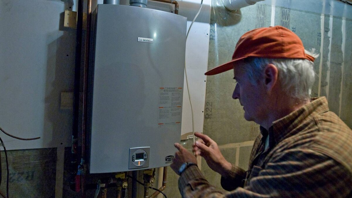"""Dave Braden believes his home near Freelton is one of the most energy efficient homes in Canada. Braden uses a propane opperated """"on demand,"""" hot water heater and well water."""