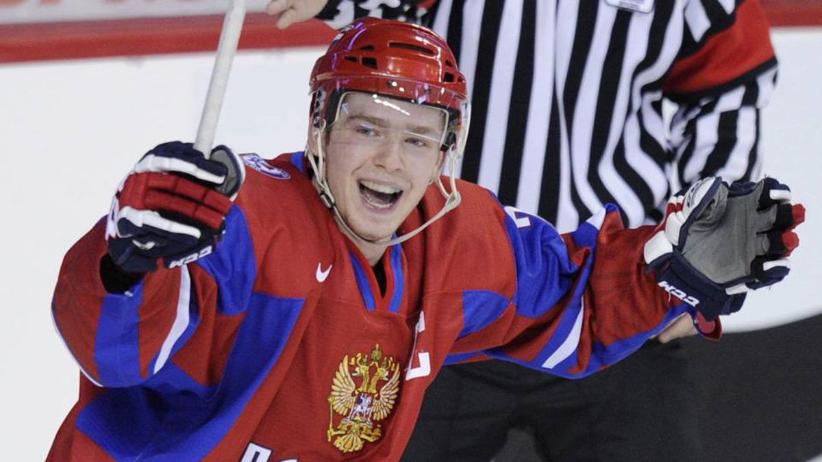 Russia's Yevgeni Kuznetsov celebrates a goal against Latvia during the third period of play