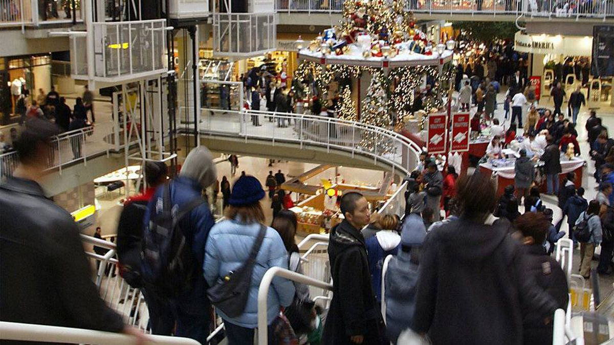 Holiday shoppers race through the Eaton Centre in Toronto on Monday, Dec. 23, 2002.