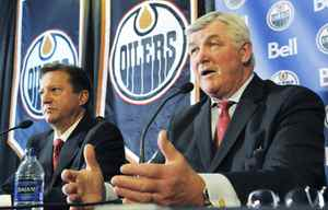 Pat Quinn (right) is joined by Edmonton Oilers General Manager Steve Tambellini as he speaks to reporters after being inveiled as the NHL's Edmonton Oilers new head coach, at Rexall Place, in Edmonton, Alberta on Tuesday, May 26, 2009.The 66 year old Quinn becomes the oldest coach in the NHL. THE CANADIAN PRESS/ Ben Lemphers