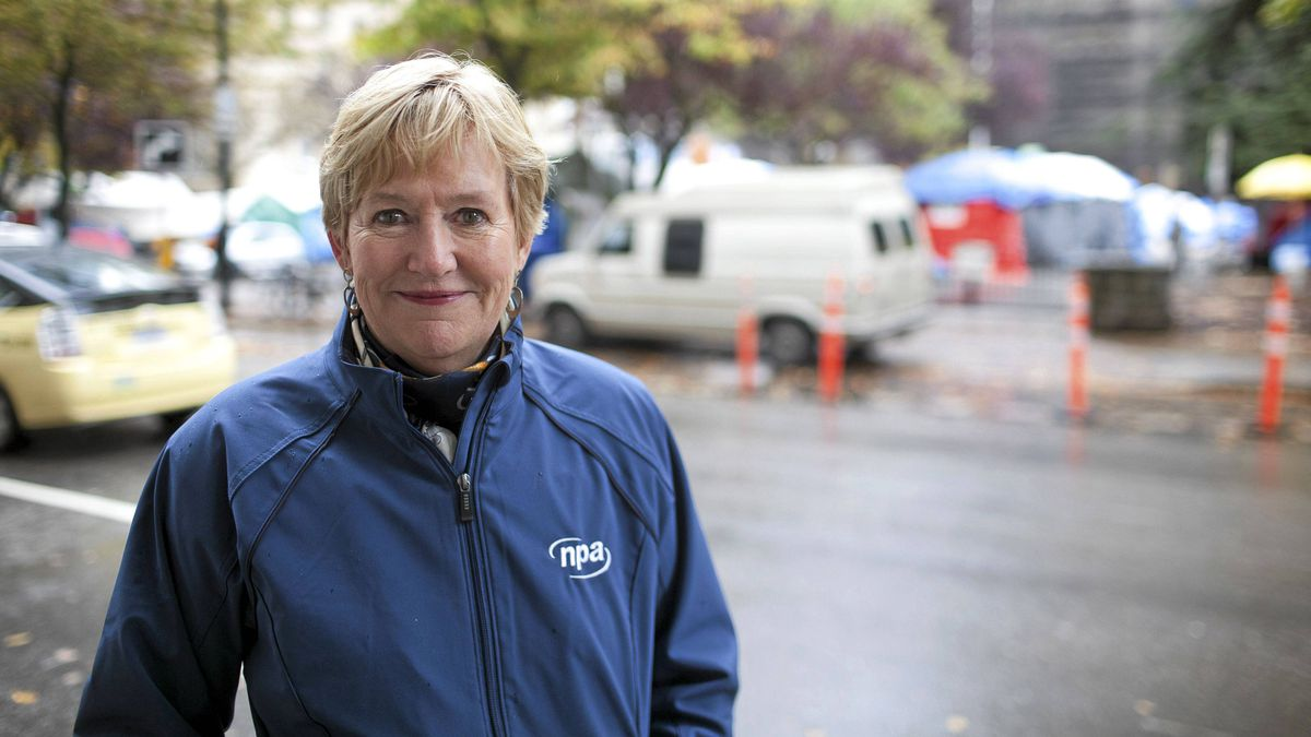 Vancouver mayoral candidate Suzanne Anton poses for a photo across the street from the Occupy Vancouver tent city on OCt. 26, 2011.