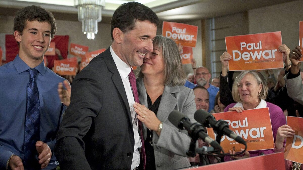 Paul Dewar is embraced by his wife Julia Sneyd as son Nathaniel looks on at the launch of the Ottawa MP's bid for the NDP leadership on Oct. 2, 2011.