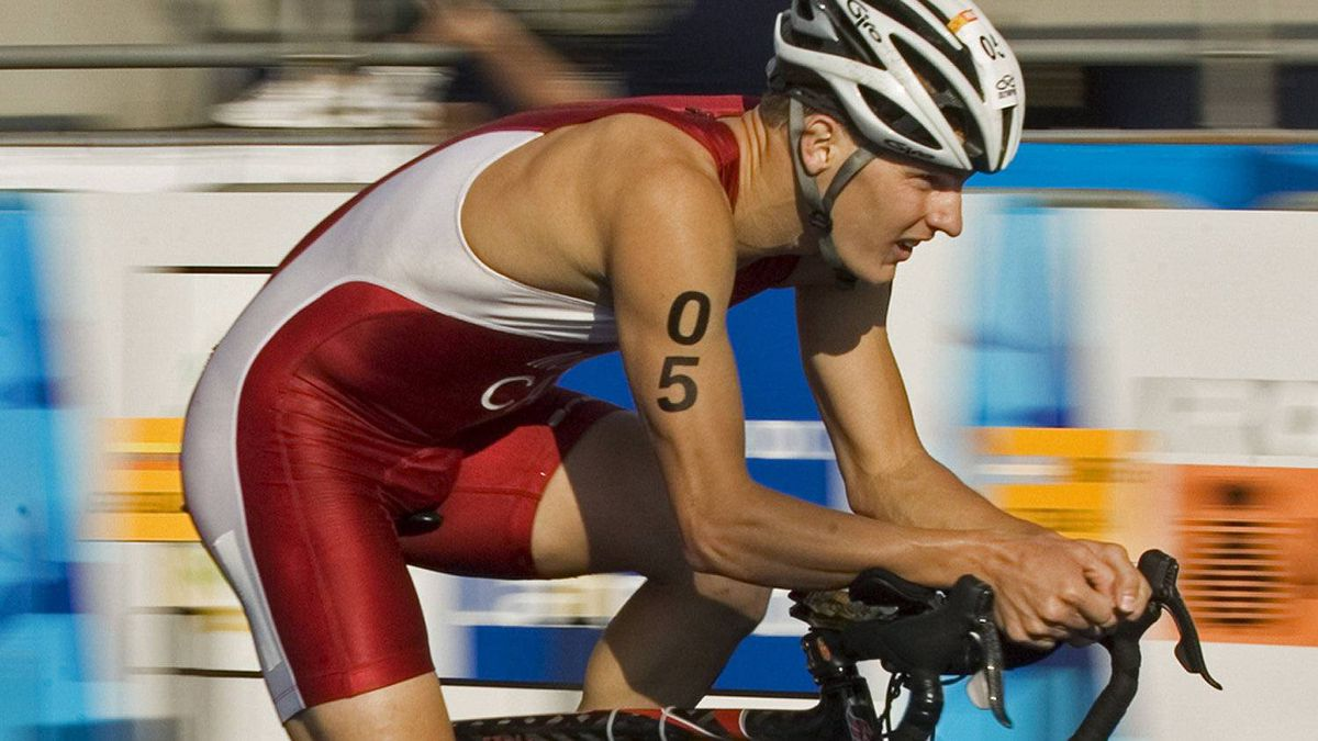 Canada's Brent McMahon, right, from Victoria, B.C. rides in front of Juraci Moreira from Brazil in the men's triathlon at the Pan American Games in Rio de Janeiro on Sunday, July 15, 2007. McMahon won silver and Moreira won bronze. (CP PHOTO/Andrew Vaughan)