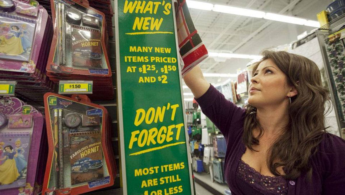 Dollarama employee restocks shelves at the store in Vaughan, Ont.