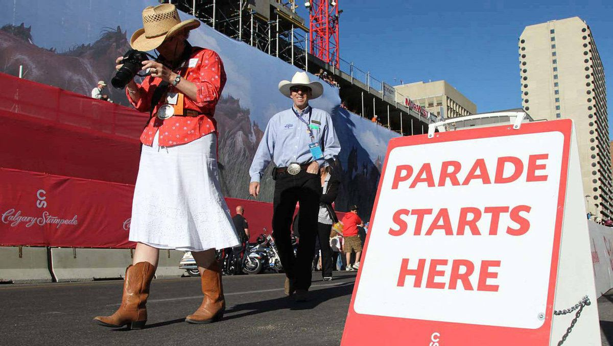 Early arrivals at the start of Calgary Stampede parade in Calgary, July 8, 2011. The Duke and Duchess of Cambridge are to take part in the annual parade later in the morning.