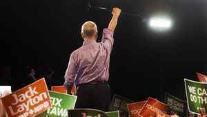 NDP Leader Jack Layton raises his cane to the crowd at a campaign rally in Burnaby, B.C. on Saturday, April 30