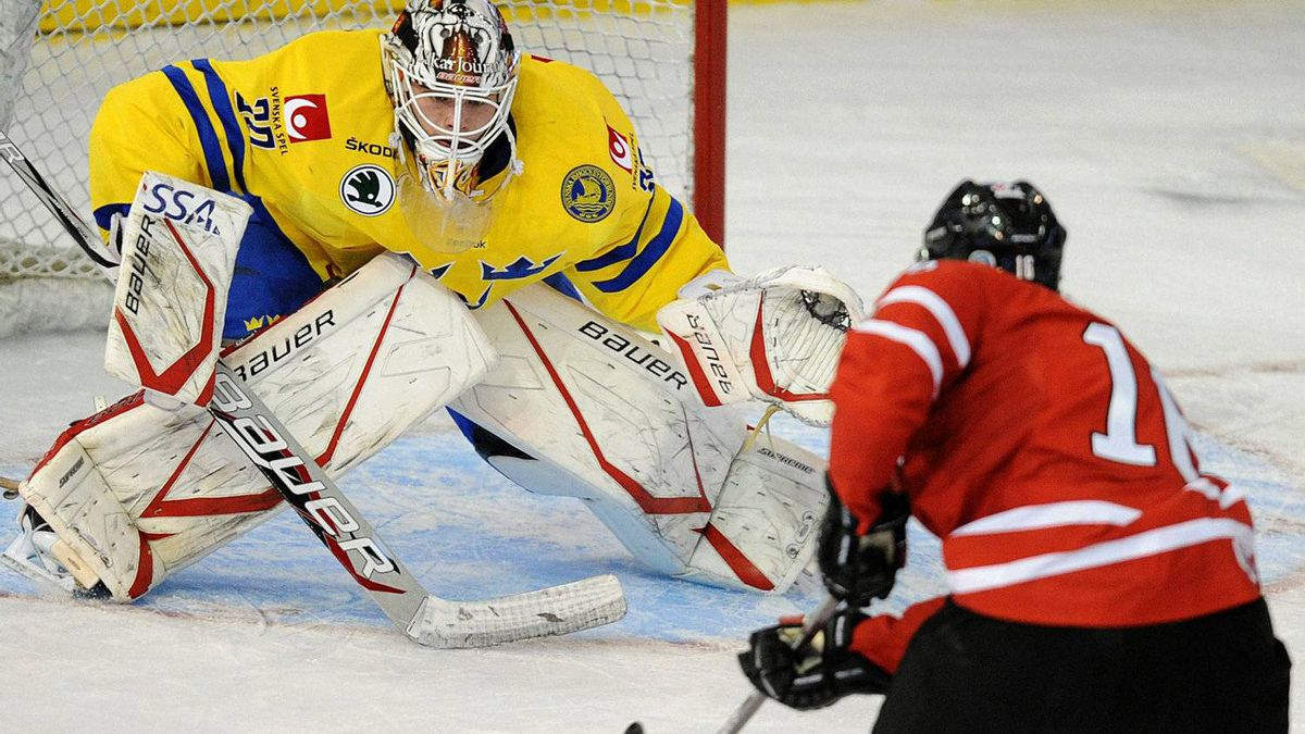 Team Canada's Mark Stone, right, scores onTeam Sweden's goalie Johan Gustafsson during first period exhibition hockey action in preparation for the upcoming IIHF World Junior Championships in Edmonton, Alta., on Friday, Dec. 23, 2011. THE CANADIAN PRESS/John Ulan