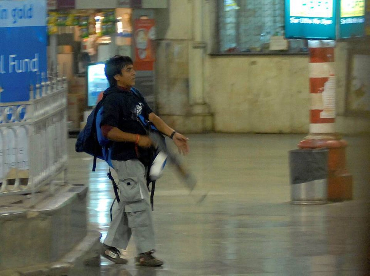 In this Wednesday, Nov. 26, 2008 file photo, an armed Mohammed Ajmal Kasab, walks at the Chatrapathi Sivaji Terminal railway station in Mumbai, India. An Indian court convicted the Pakistani gunman Monday, May 2, 2010, for the 2008 Mumbai attacks.