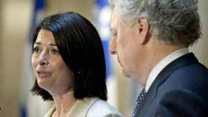 With Premier Jean Charest looking on, Line Beauchamp announces her resignation as education minister and deputy premier at a Quebec City news conference on May 14, 2012.