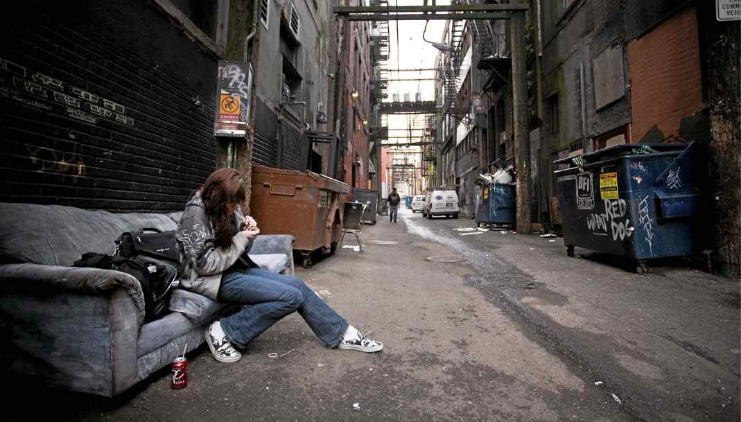 A drug user smokes crack in Vancouver's Downtown Eastside in February of 2009.