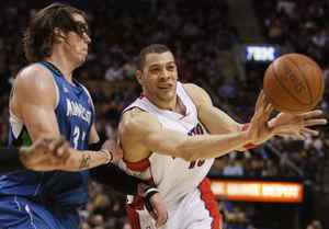 Mike Miller, seen trying to stop Anthony Parker of the Toronto Raptors in an NBA regular-season game, is moving from Minnesota to Washington.