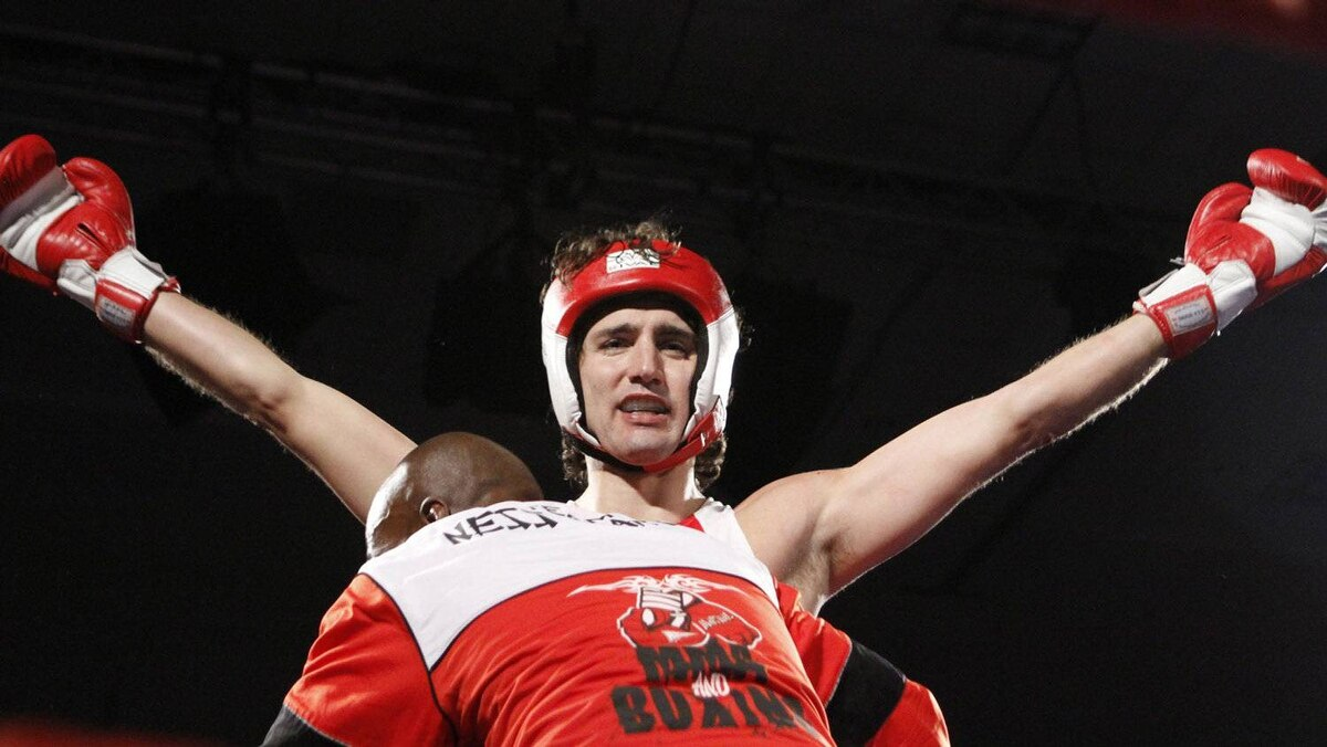 Liberal MP Justin Trudeau celebrates after he defeated Conservative Senator Patrick Brazeau during charity boxing match for cancer research Saturday, March 31, 2012 in Ottawa .